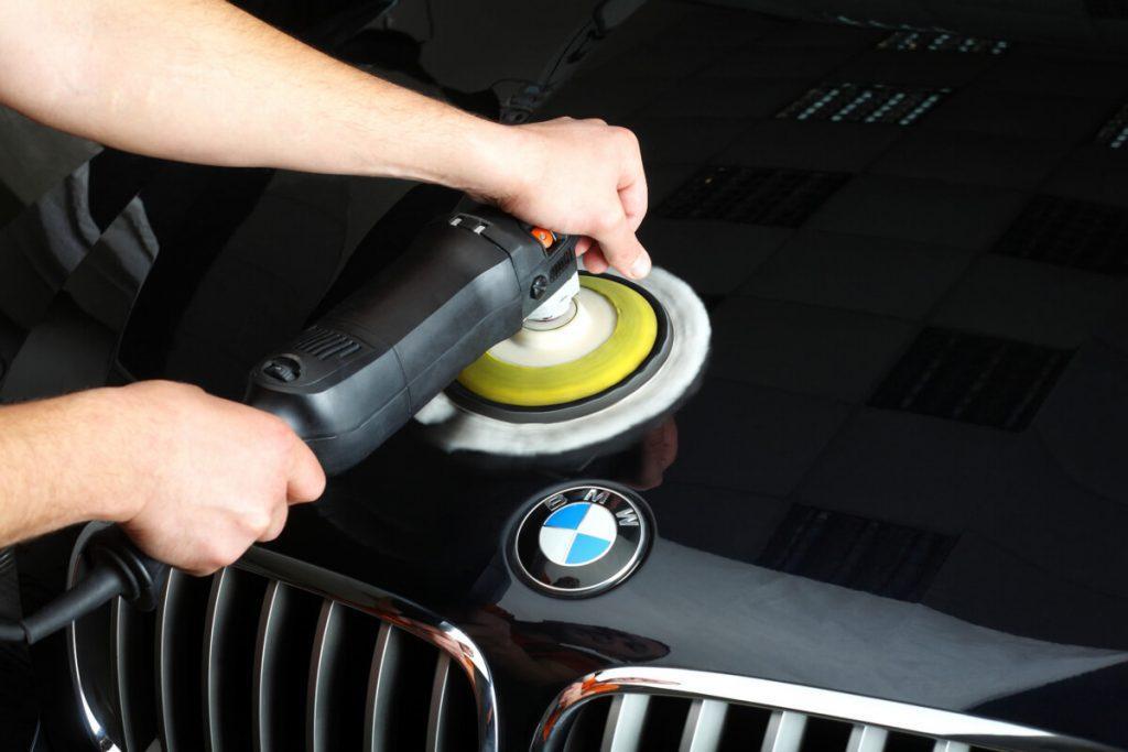man polishing a BMW