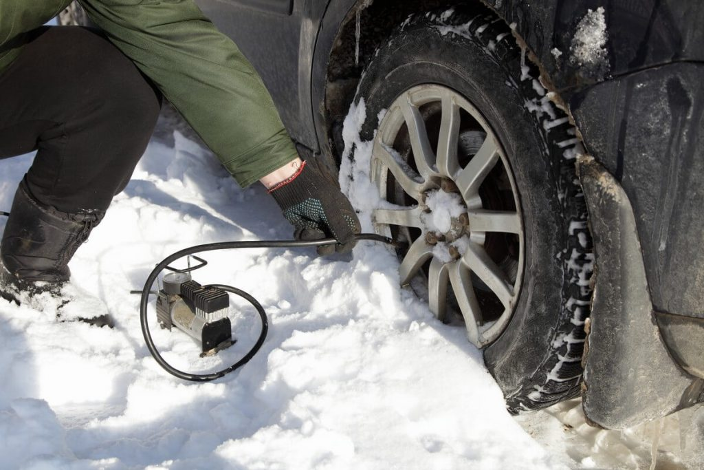 inflating tire in snow
